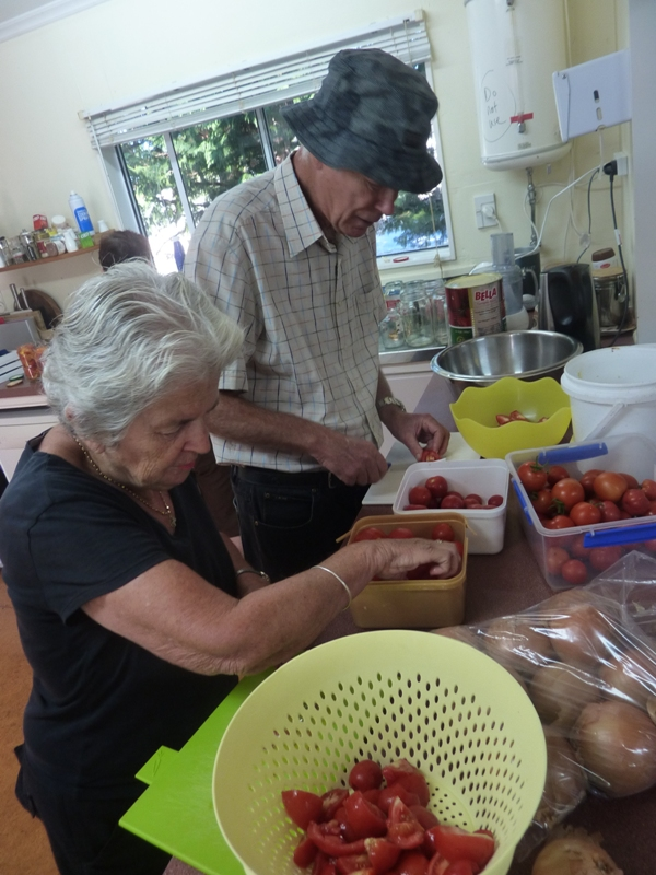 Garden stalwarts, Michael and Janet, tackling the 30 kg of tomatoes.